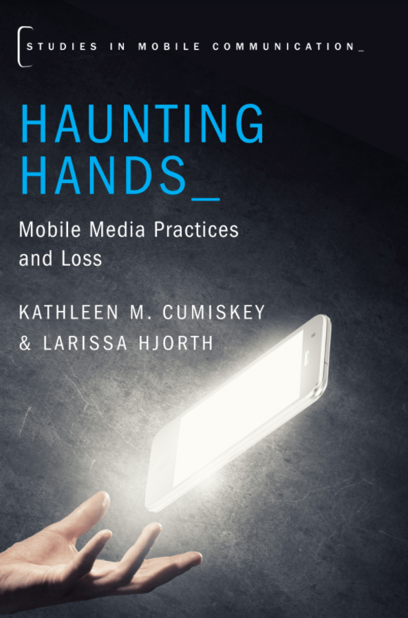 Book cover for Haunting Hands, a glowing mobile phone screen floats above an open hand